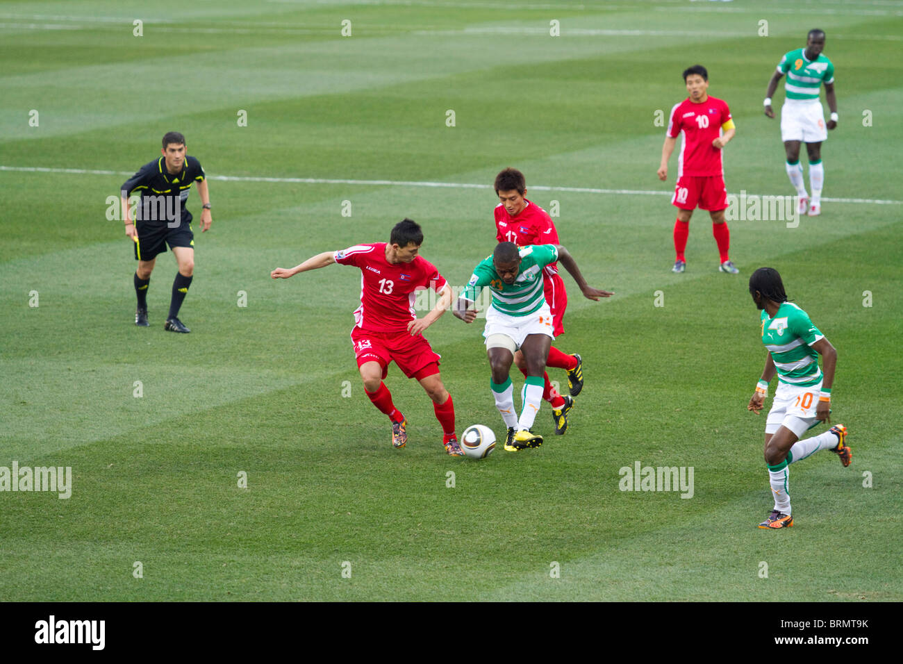 Romaric passes a through ball to Gervinho the C⌠te d'Ivoire striker during the 2010 World Cup match against - Stock Image