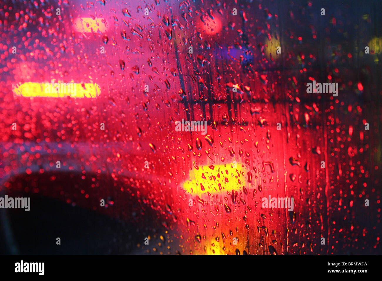 Rain drops on a car wind shield during the storm Xynthia hinder a clear view of the road. North-Rhine Westphalia, - Stock Image
