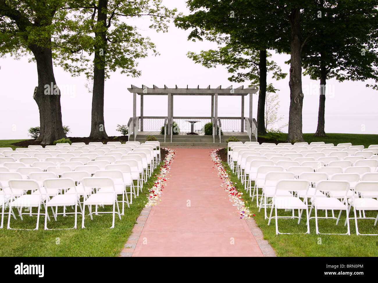 White Folding Chairs Setup For A Wedding Ceremony Stock Photo Alamy