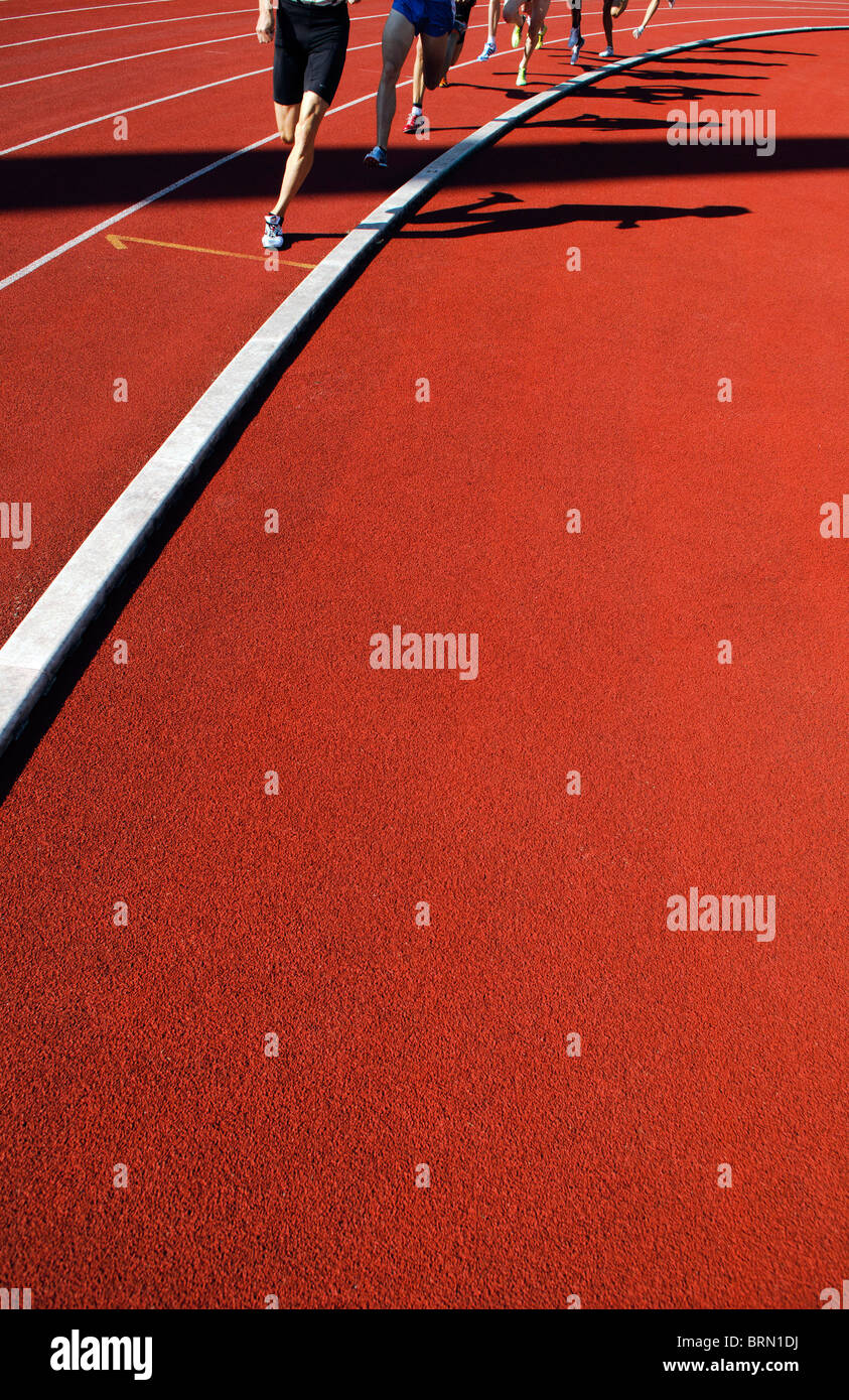shadows of runners during 800m race during outdoor track and field competition - Stock Image