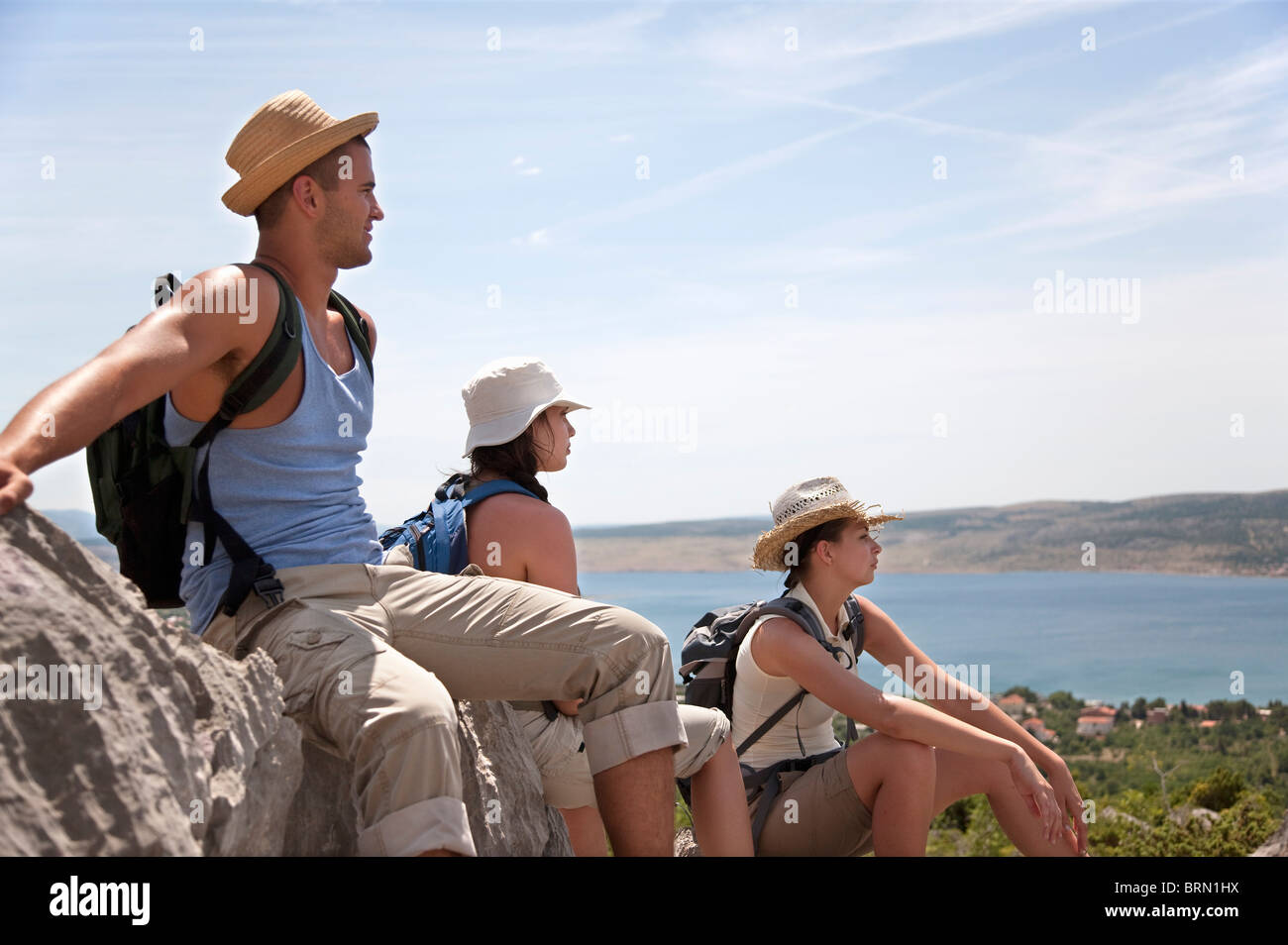Hikers resting on coastal path - Stock Image