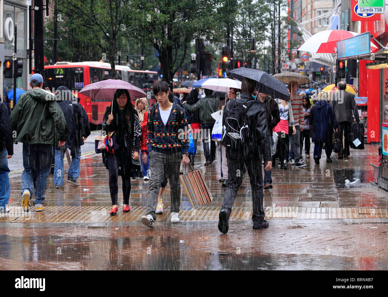 Shopping  on a cold and rainy day. - Stock Image
