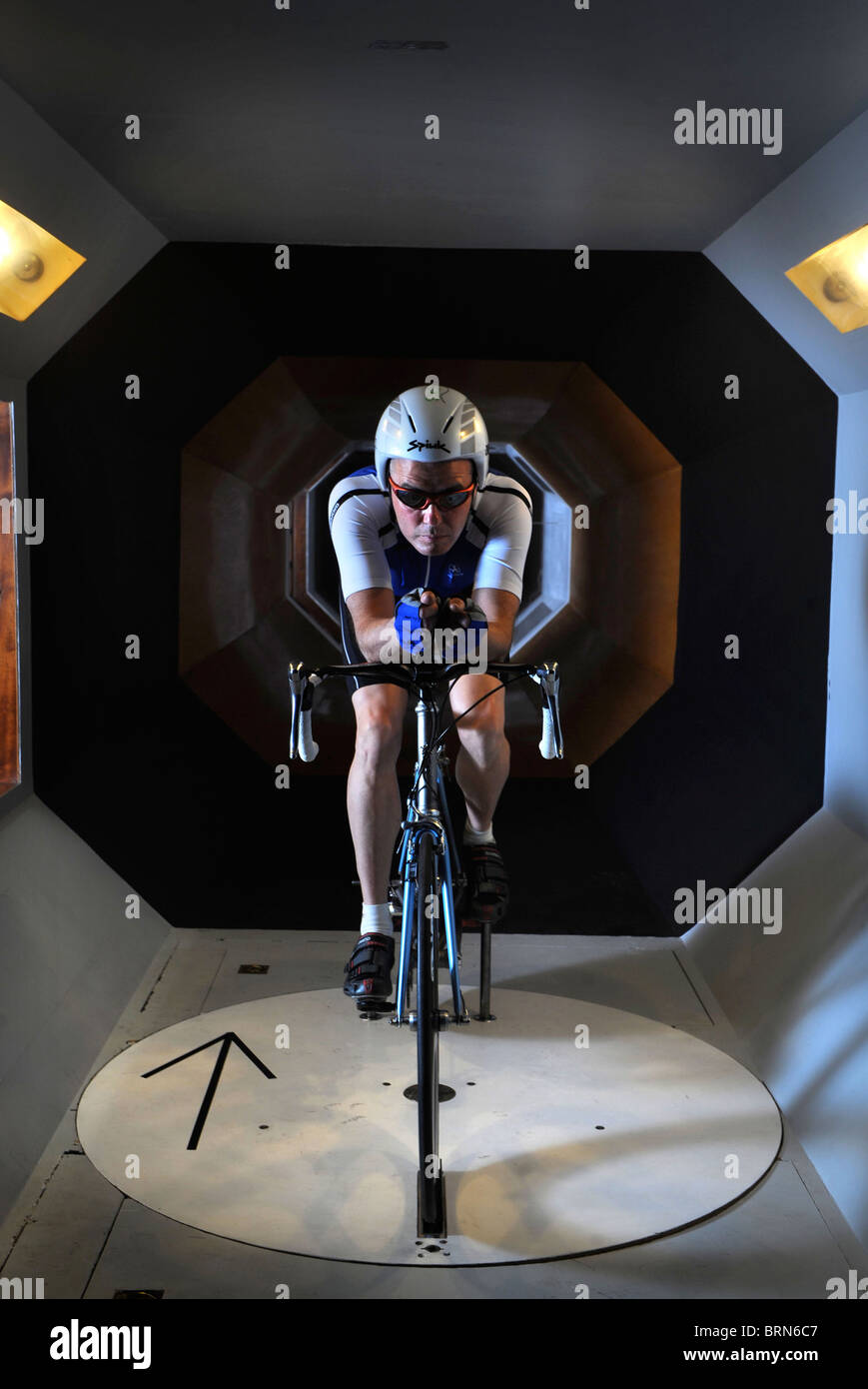 A wind tunnel experiment to find optimum aerodynamics for cycling clothing and racing bicycle design - Stock Image