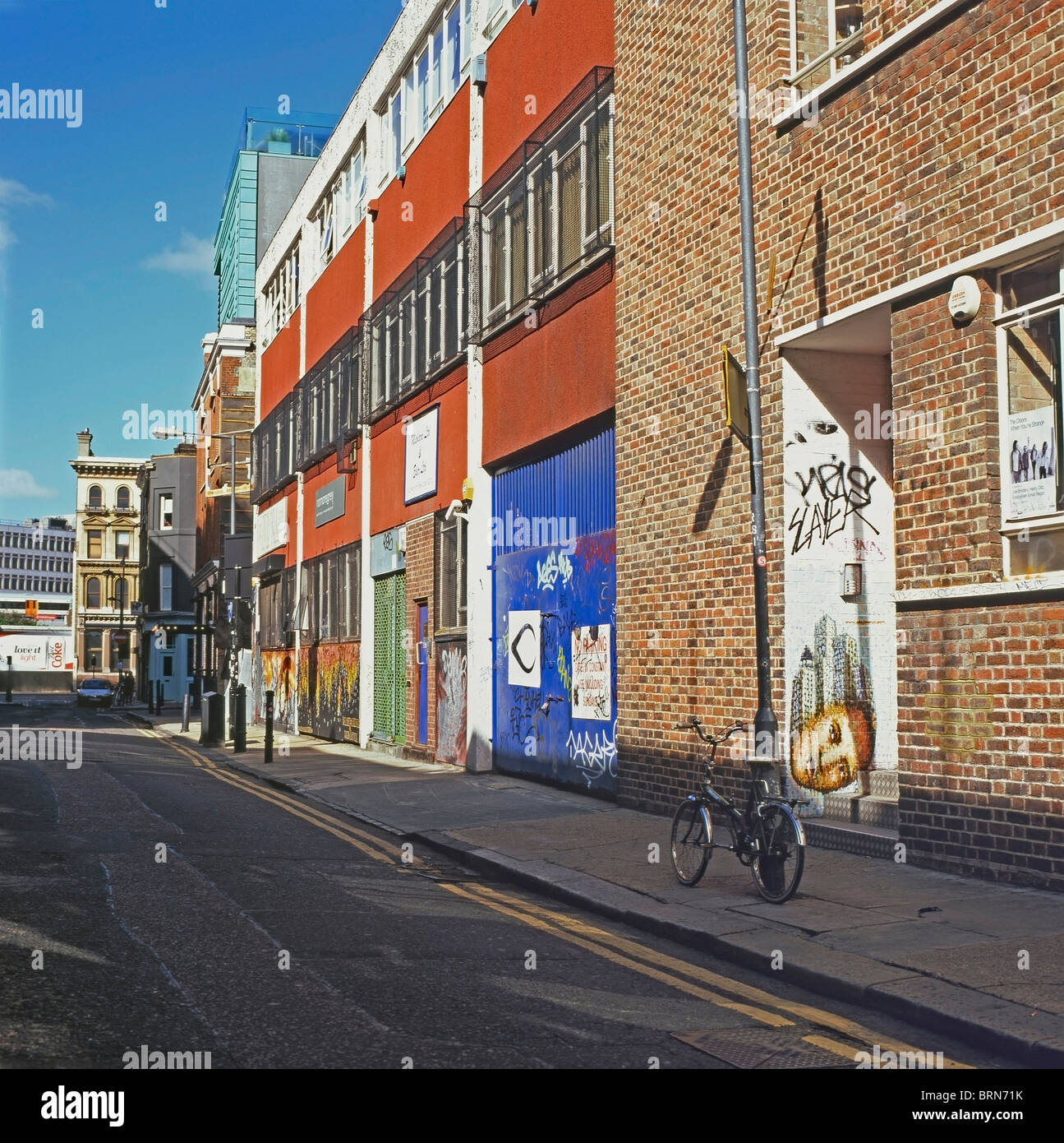An empty street with warehouses in Shoreditch, East London England UK KATHY DEWITT - Stock Image