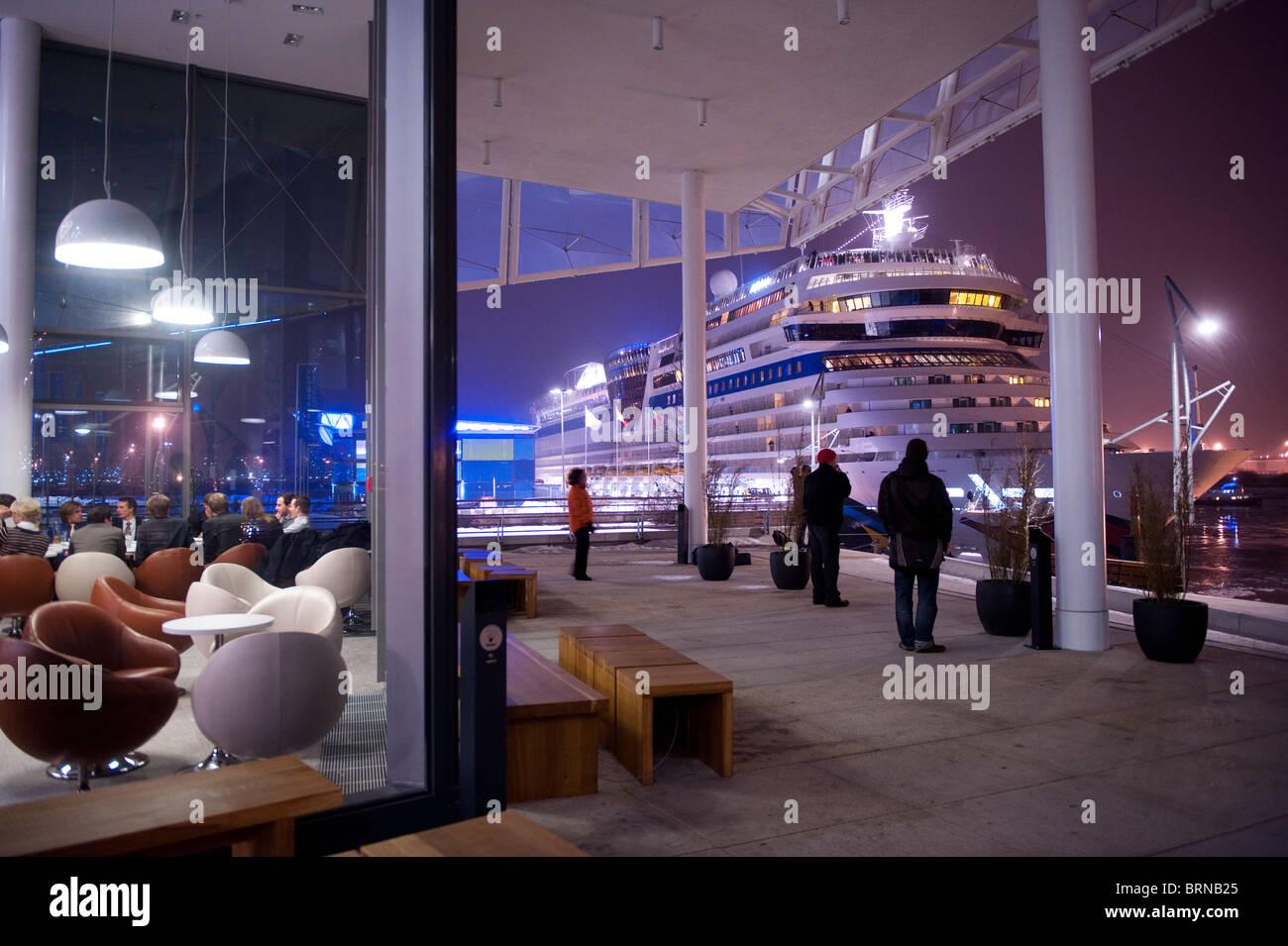 Europe Germany Hamburg, Hafencity , new harbour city , cruising terminal with passenger vessel Aida blu at night - Stock Image