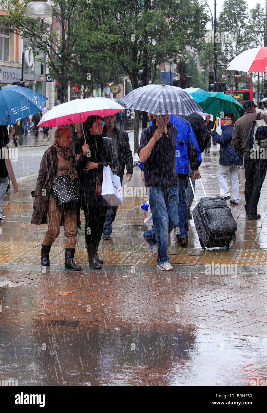 Street Shoppers on a cold and rainy day. - Stock Image
