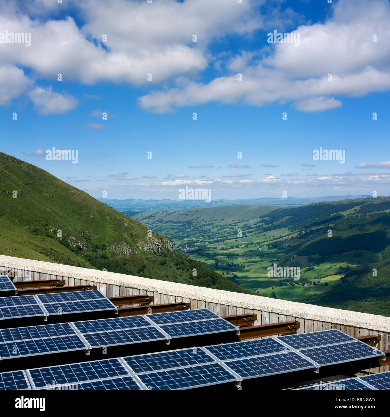 Solar panels at a solar farm with photovoltaic array in the countryside - Stock Image