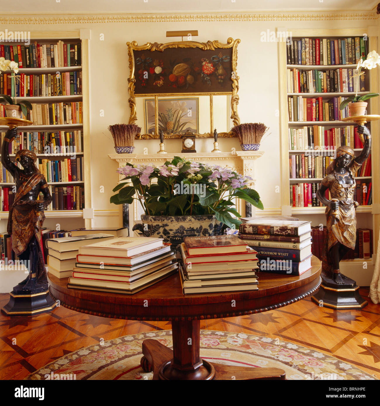Books In Piles On Circular Antique Table Library Dining