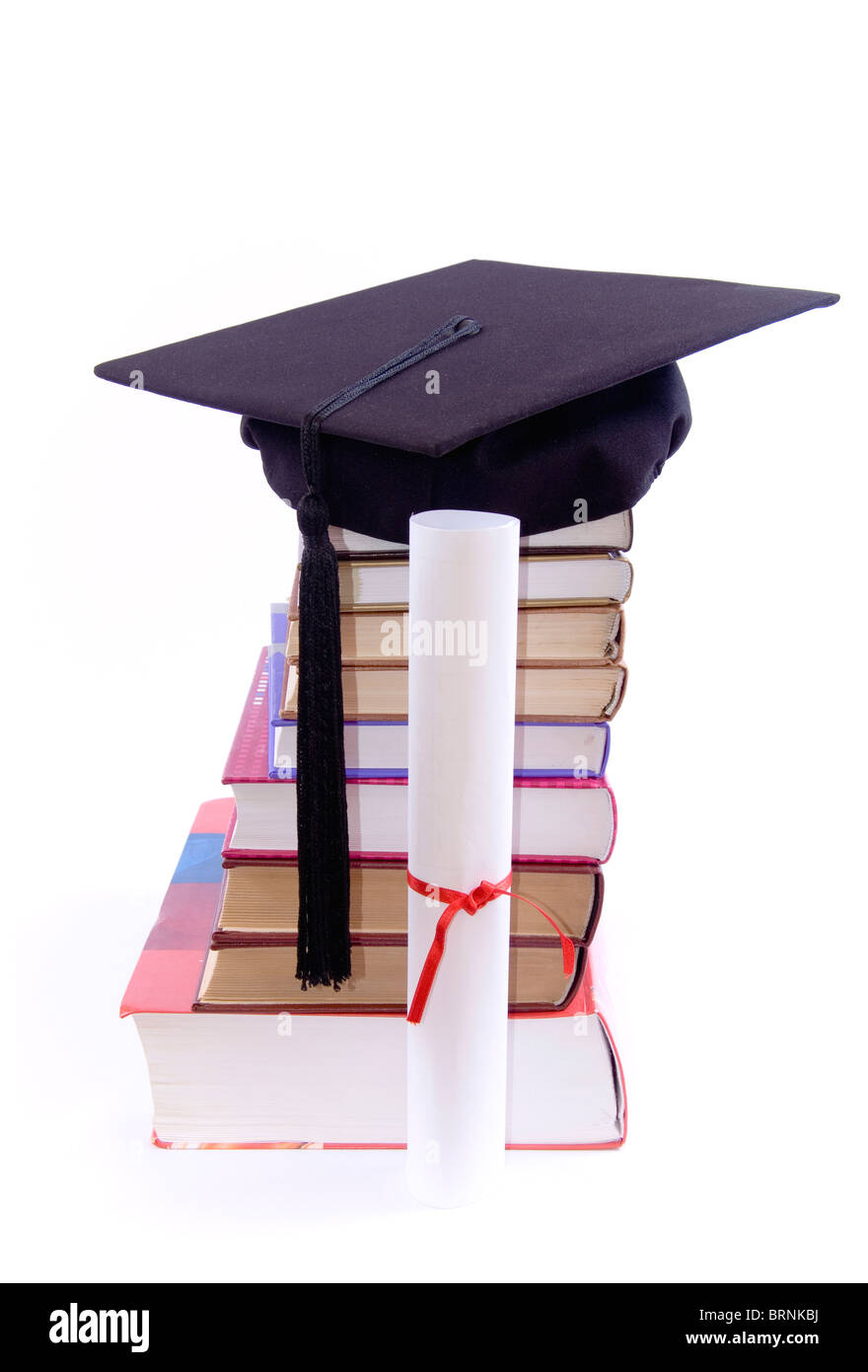 A lot of books, tower made of books with student hat on it, and diploma, against a white background - Stock Image