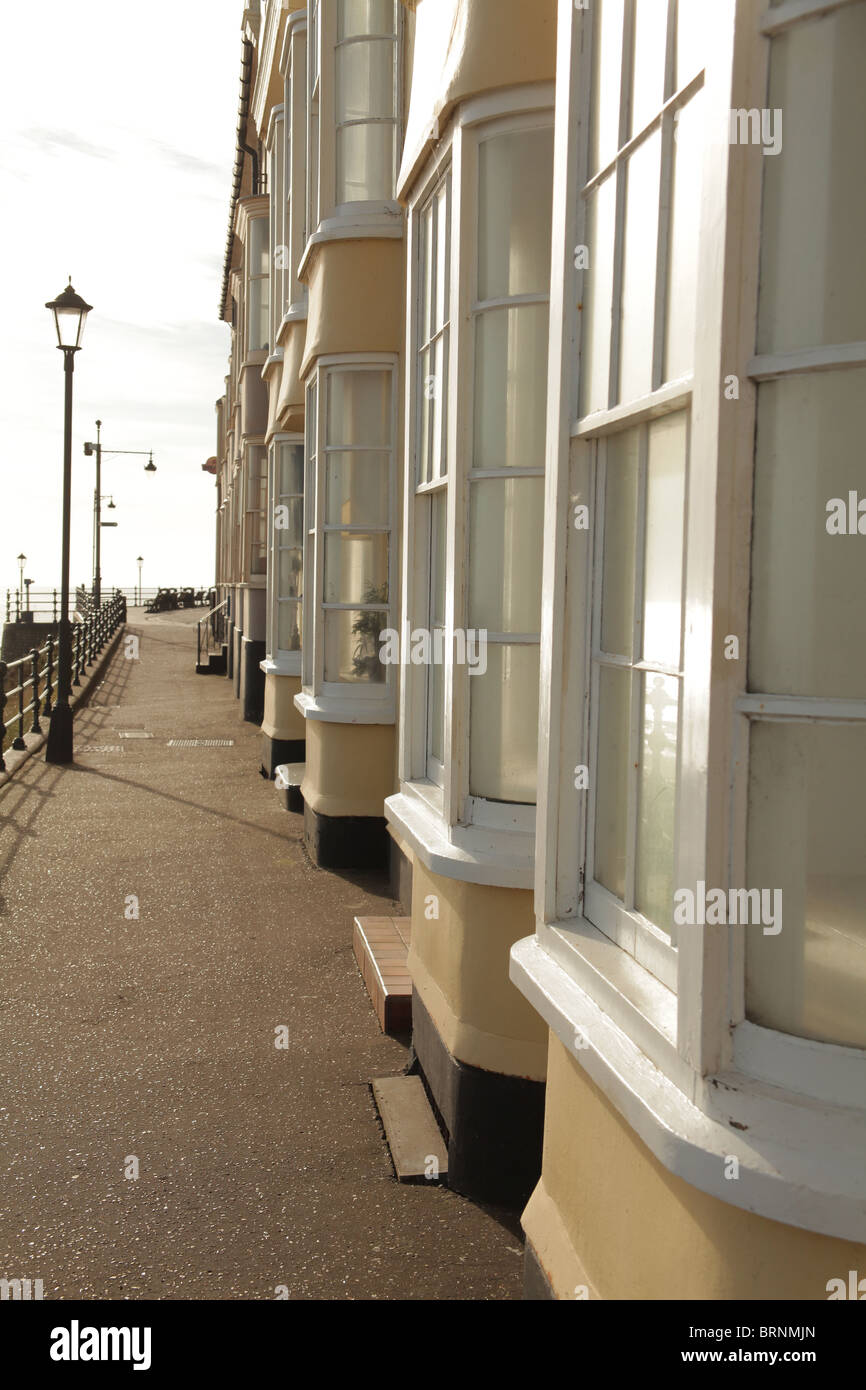 A side on view of seafront bay windows - Stock Image
