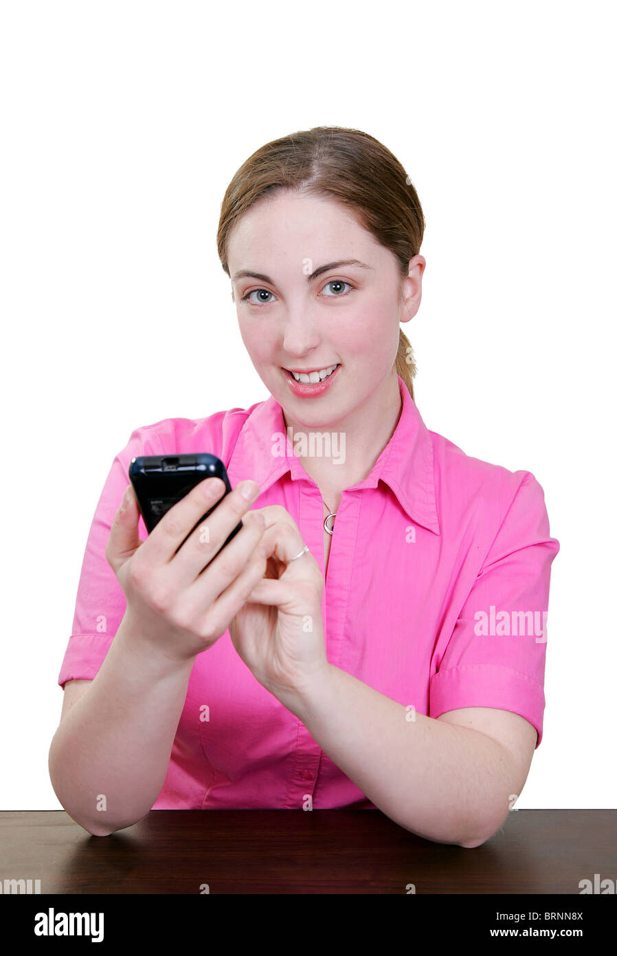 happy smiling girl using her pda personal assistant and stylus - Stock Image