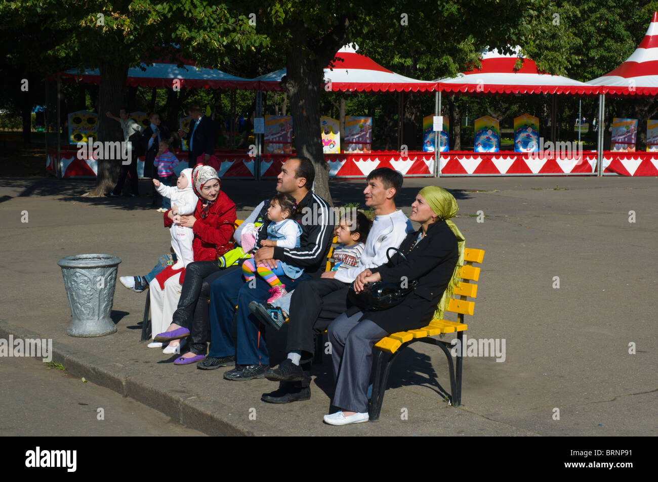Muslim people watching people on a ride in Gorky Park central Moscow Russia Europe Stock Photo
