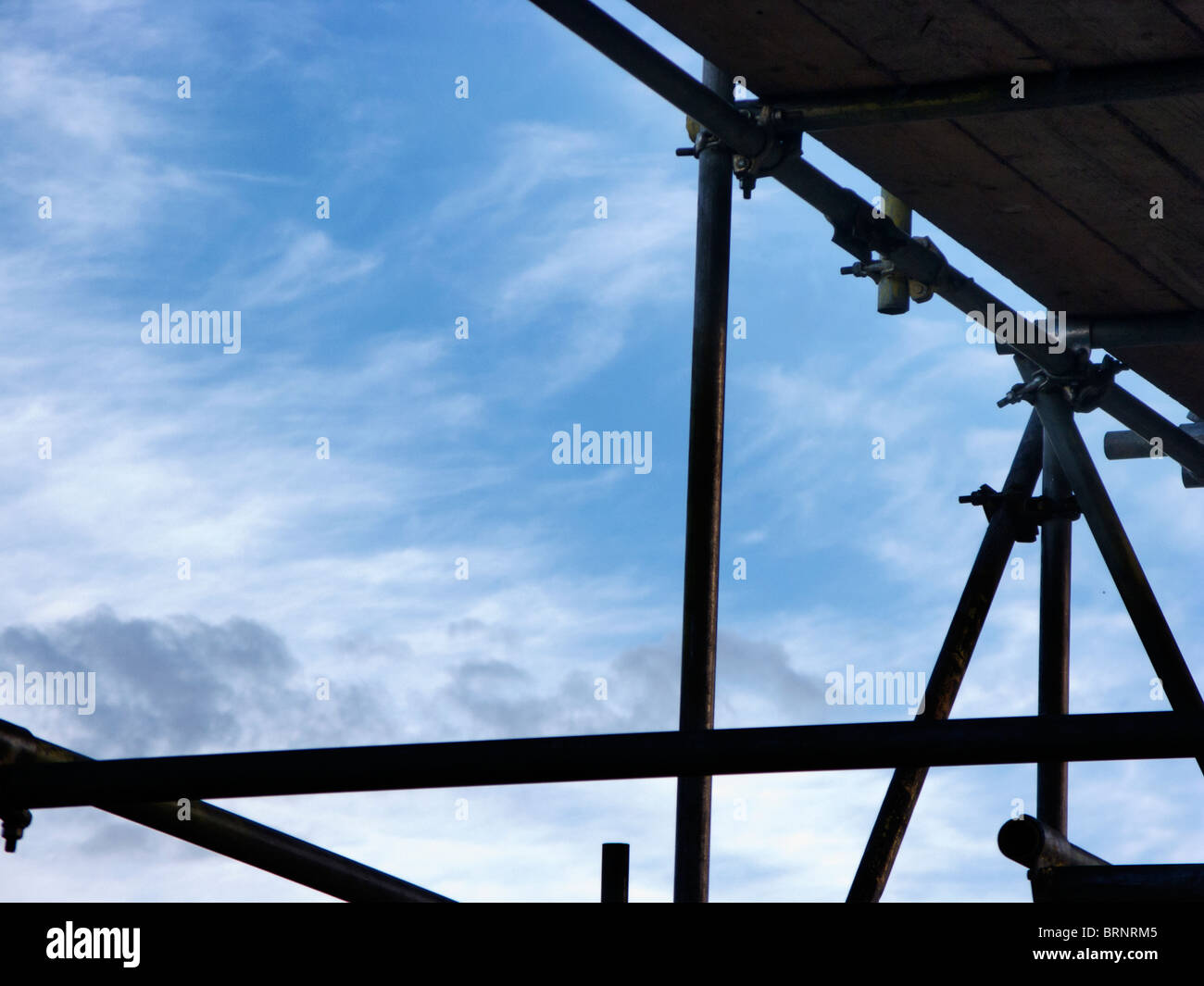 scaffolding againts a blue sky ready to build - Stock Image