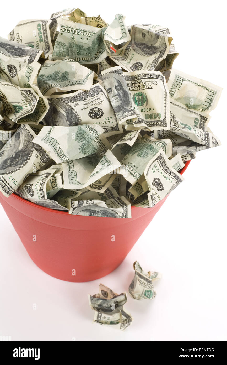Dollars in Red Garbage Can with White Background - Stock Image