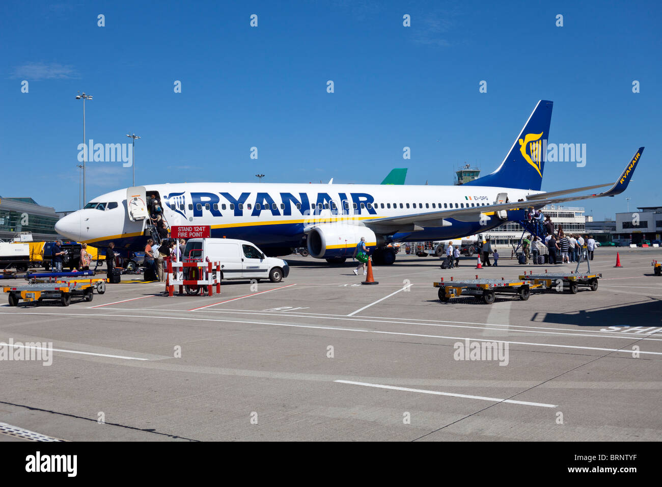 passengers boarding RyanAir flight, Dublin airport, Ireland - Stock Image