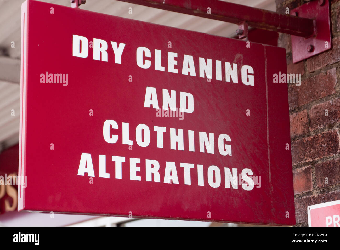Dry Cleaning and Clothing Alterations sign - Stock Image