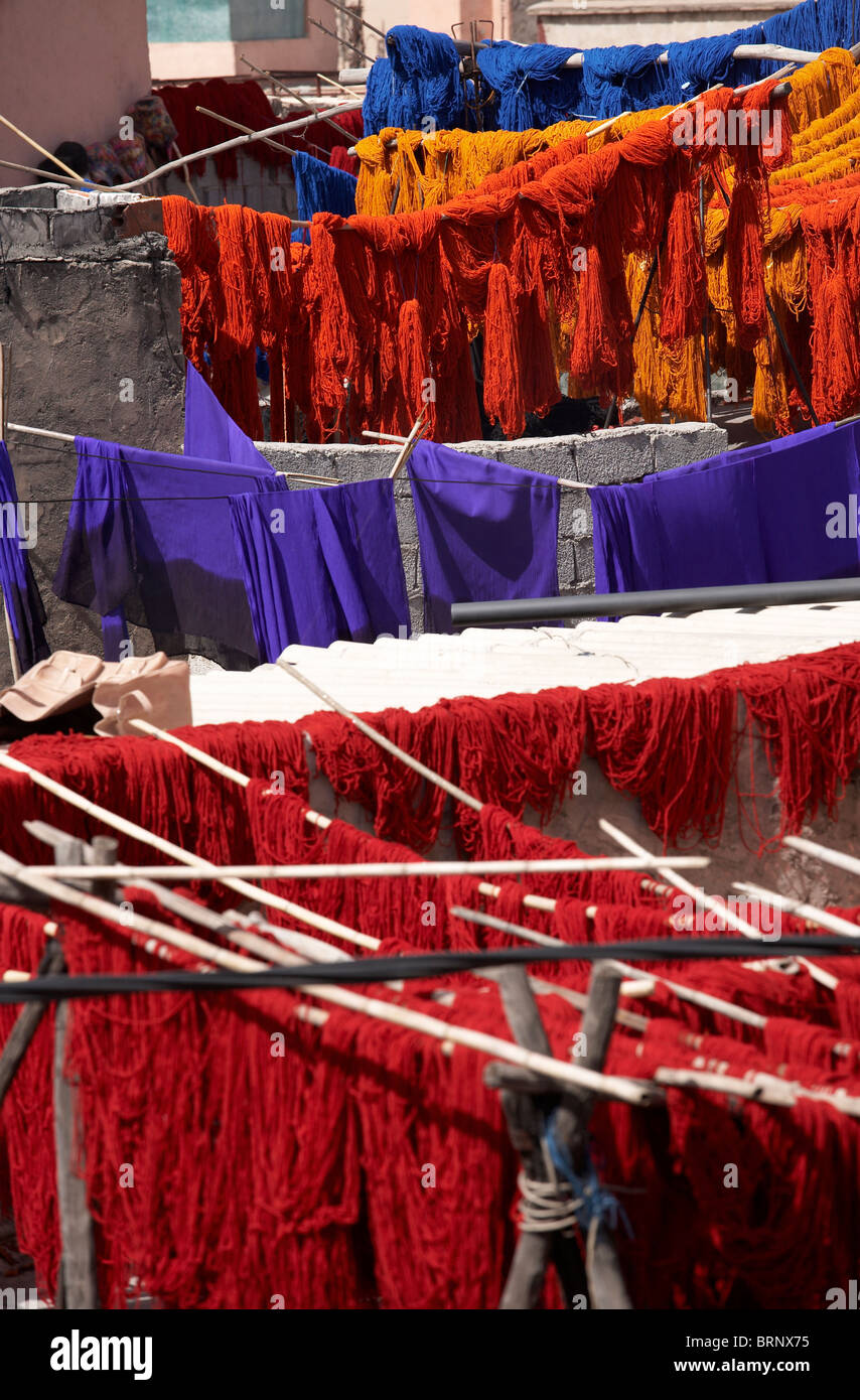 MARRAKESH: FRESHLY DYED FABRIC AND WOOL HANGING ON LINES - Stock Image