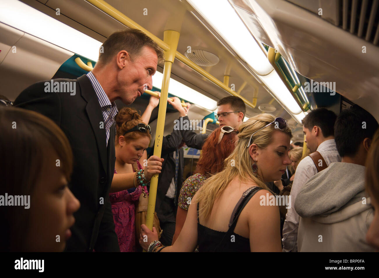 crowded tube carriage, London Underground, London, England - Stock Image