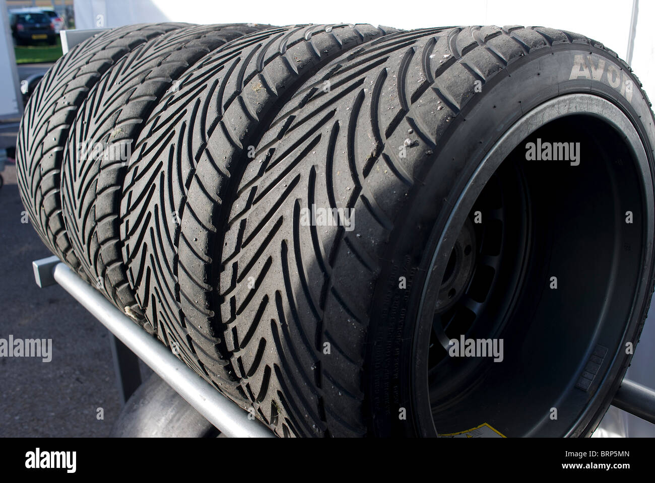 Racing Tyres in a rack - Stock Image