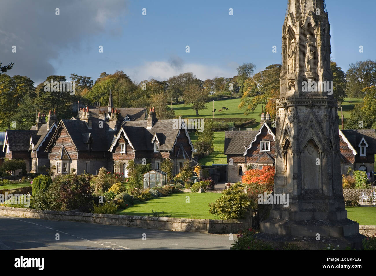 Cottages and memorial cross in Ilam, Staffordshire, Peak District National Park, England, UK - Stock Image