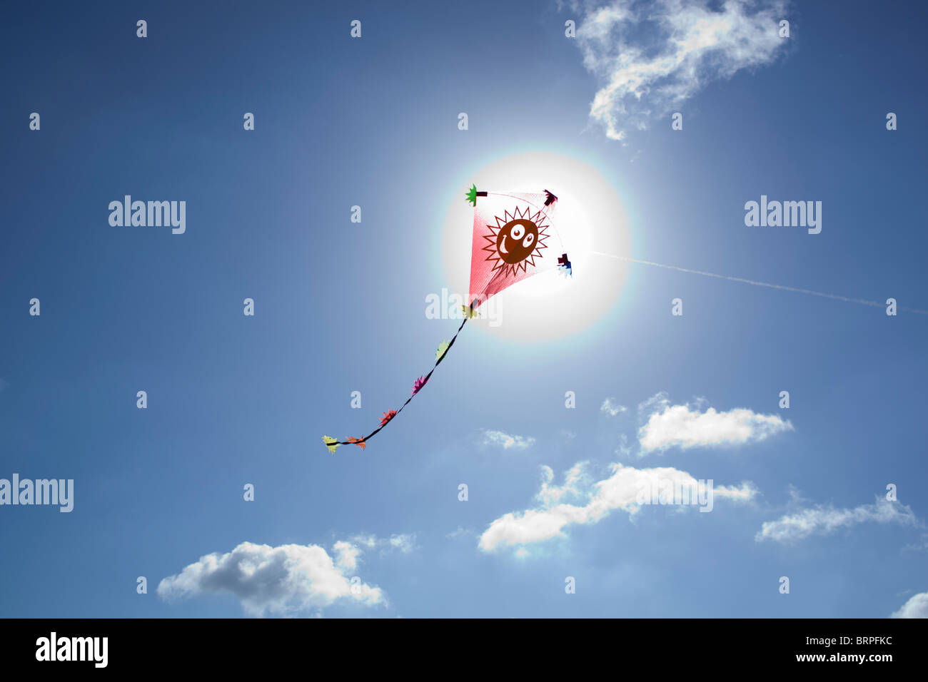 Kite in front of the sun Stock Photo