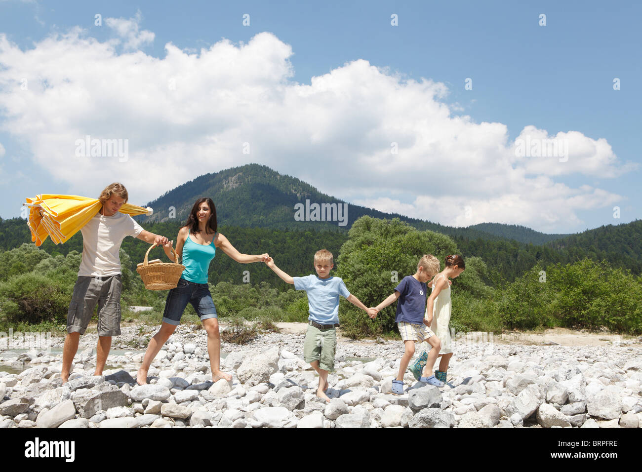 Free Time by the River in the Mountains - Stock Image