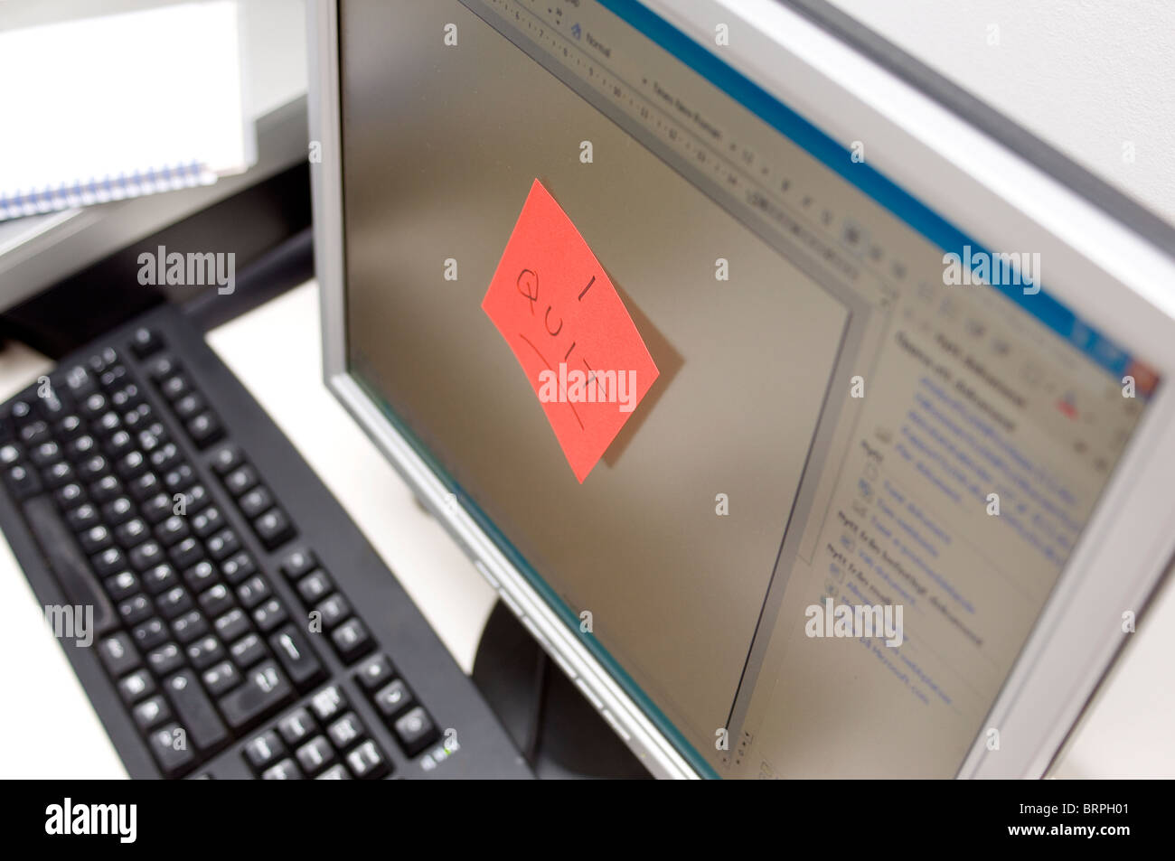 I quit note on computer screen monitor - Stock Image