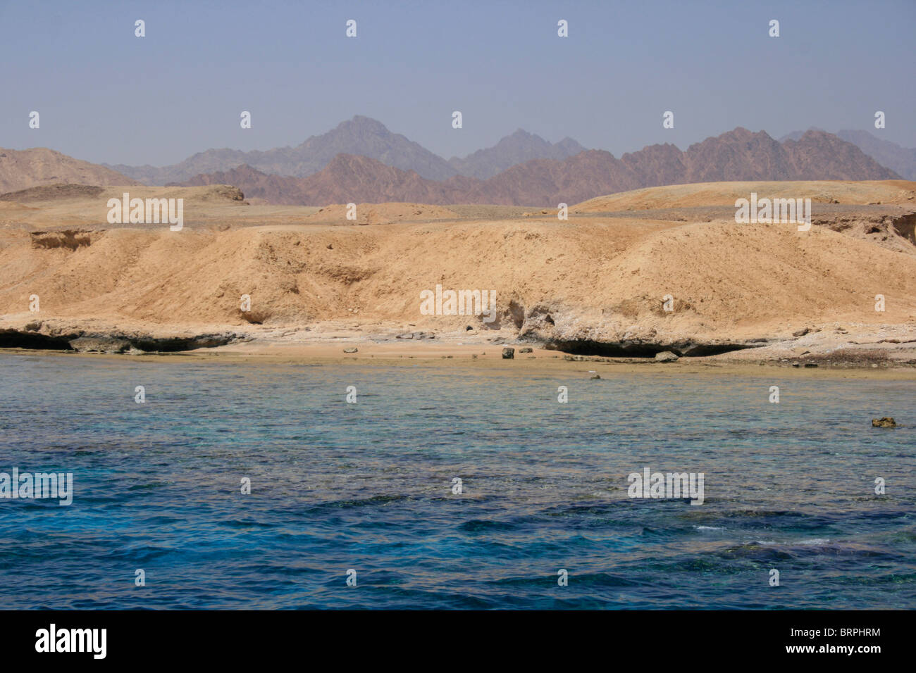 The Red Sea and arid landscape of the Sinai Peninsula, Ras Mohammed, Egypt - Stock Image