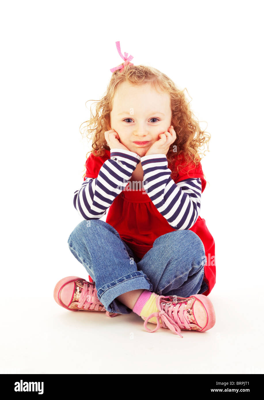 portrait of young girl looking bored and stroppy - Stock Image