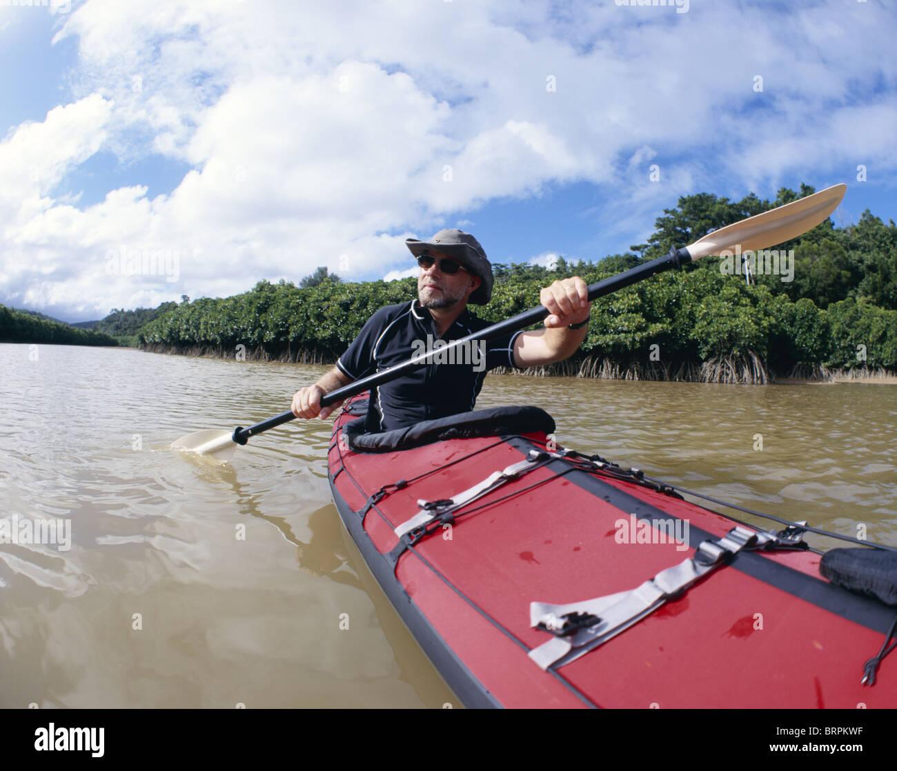 Kayaking along mangrove lined river, Okinawa Japan  Using