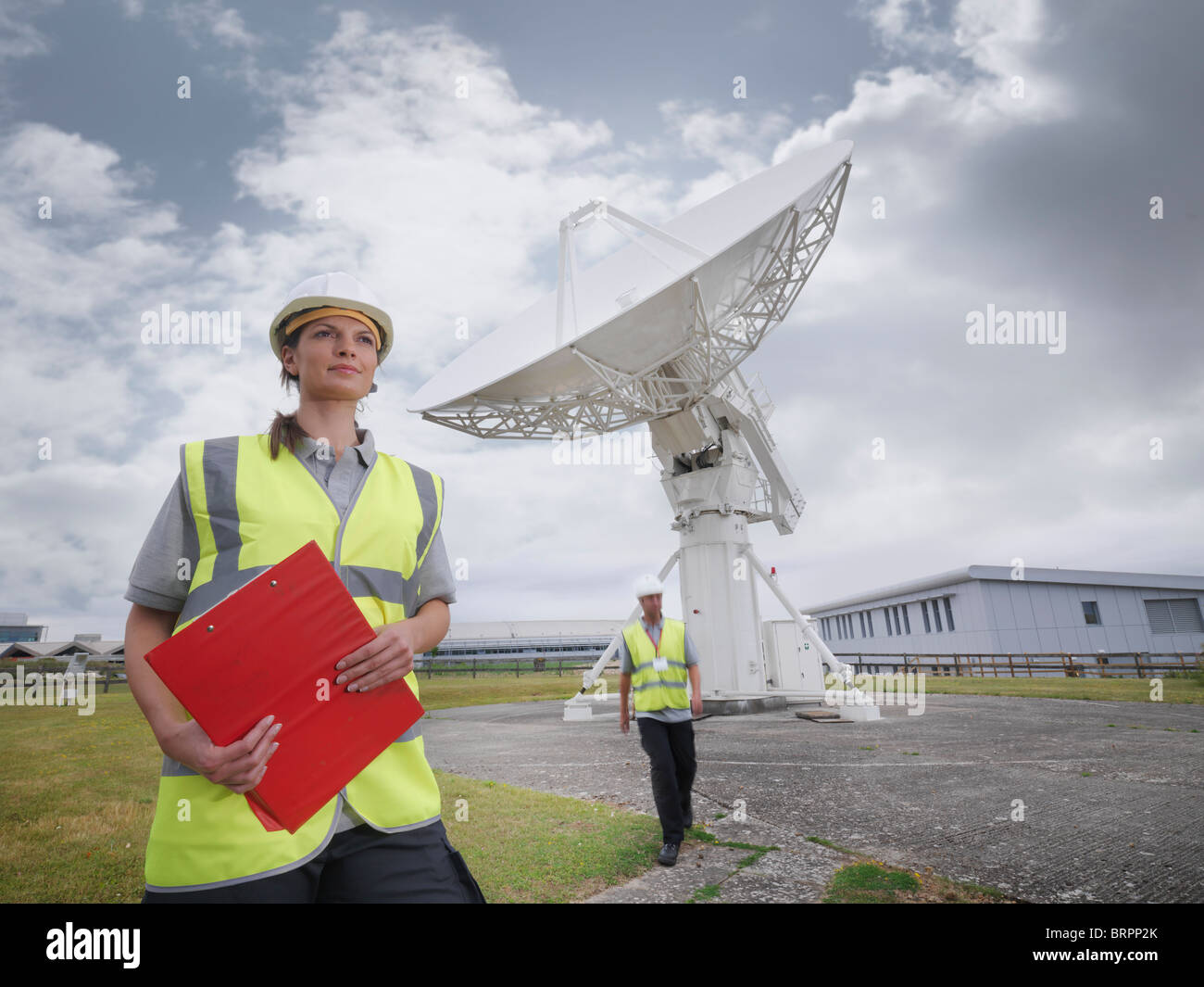 Workers with satellite dish Stock Photo