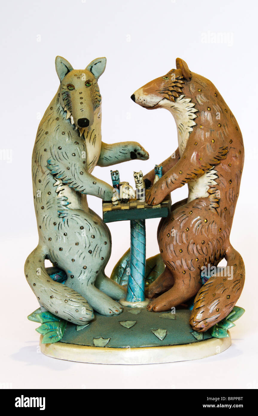 Ceramic of two foxes playing chess, by Eleanor Bartleman. - Stock Image