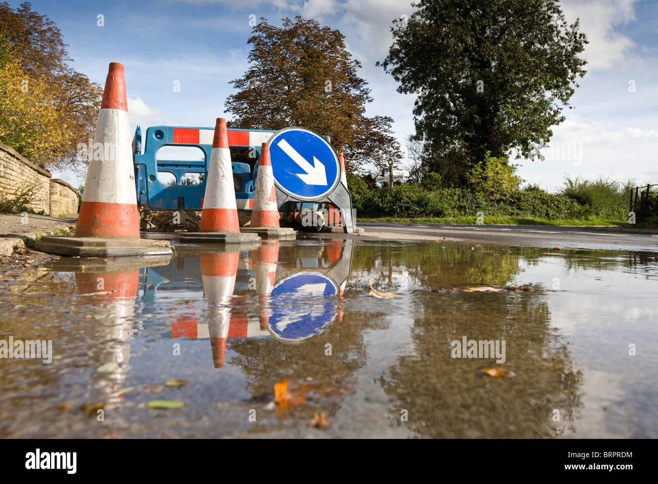 Burst Water Main In A Village Street - Stock Image