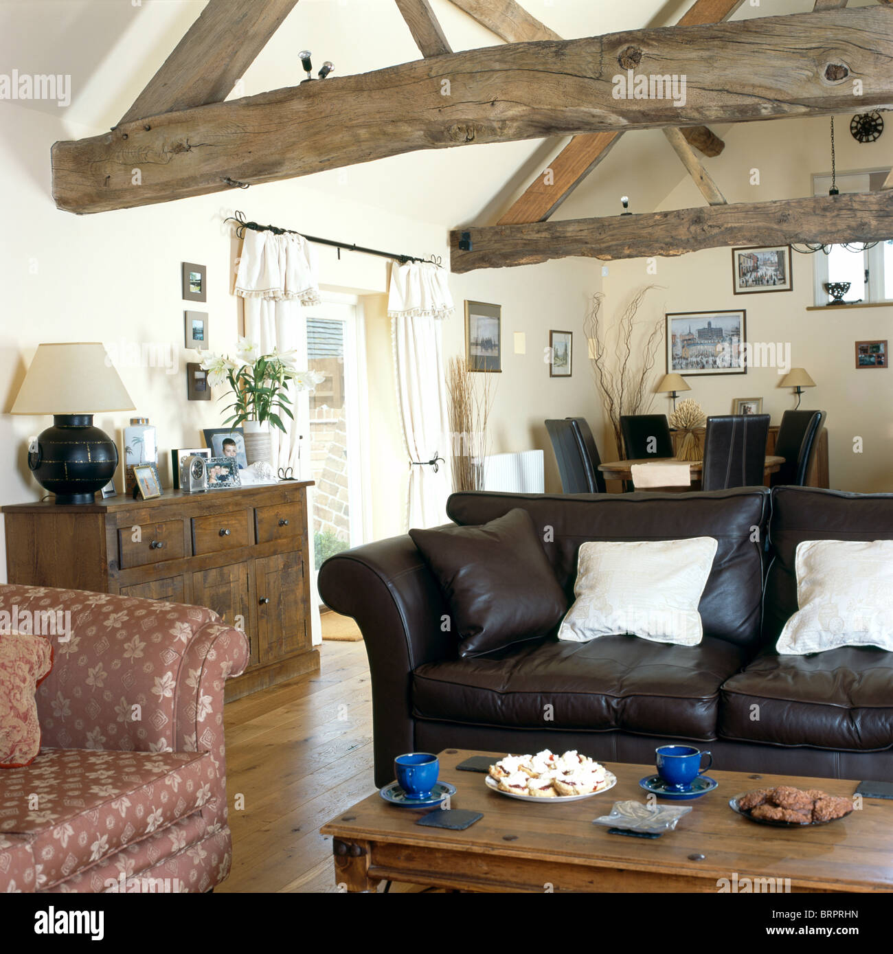 Country Leather Sofa: Black Leather Sofa And Old Wooden Chest In Country Living