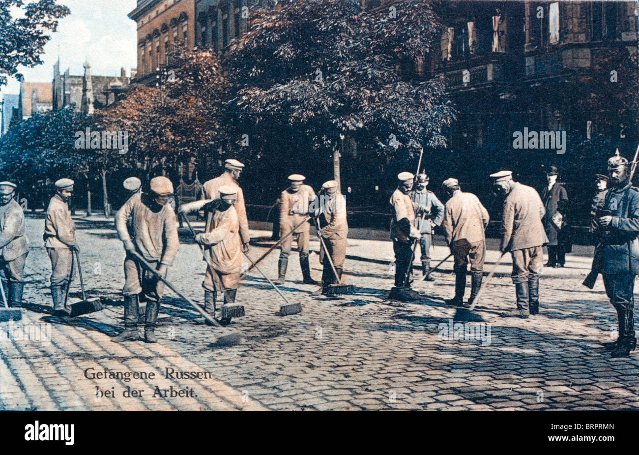 Russian prisoners of war sweeping a street in North Germany during the First World War. c1917 - Stock Image