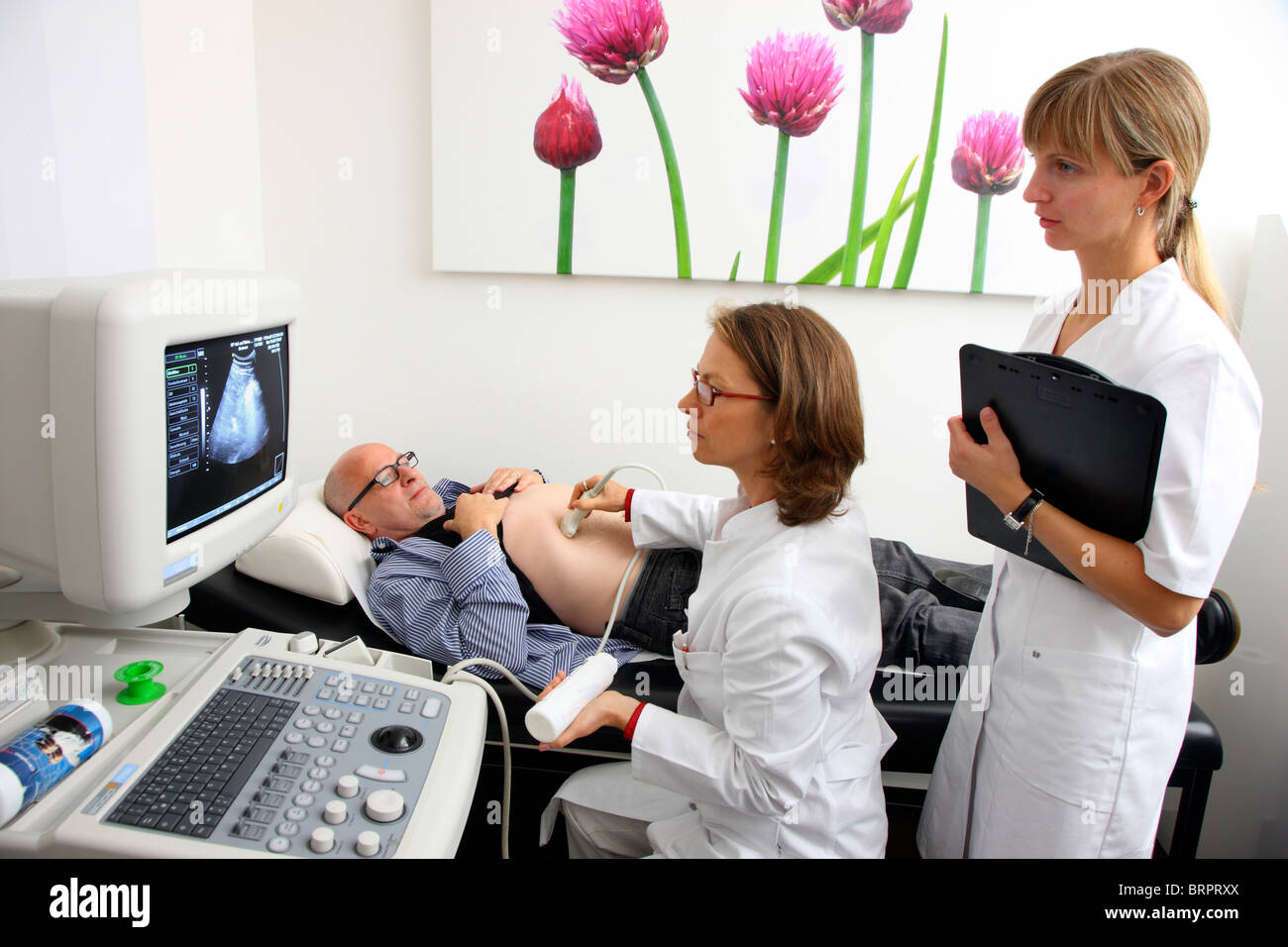 Ultrasound scanning of a male patient, medical practice in a doctors surgery. Scanning of internal organs. - Stock Image