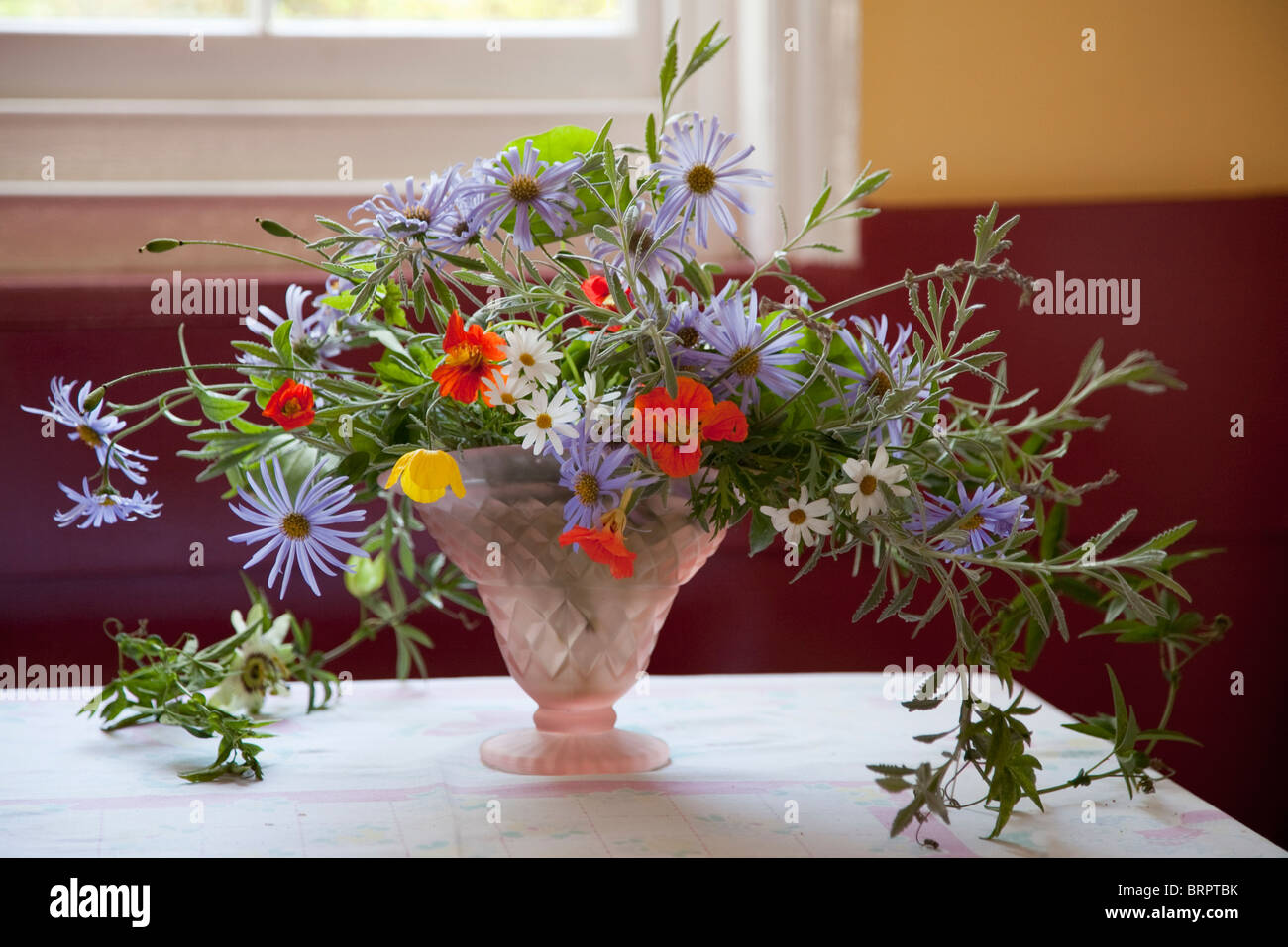 Flowers in vases and an English Garden Stock Photo