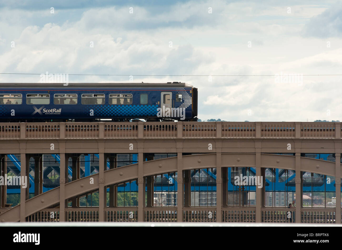 Scotrail train crossing the railway bridge on the Tyne river, Newcastle, UK - Stock Image