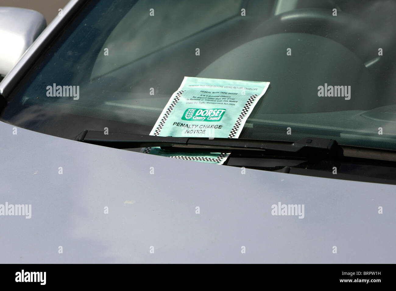 Penalty Charge Notice better known as a Parking Ticket on a windscreen of a car having been issued by a Traffic - Stock Image