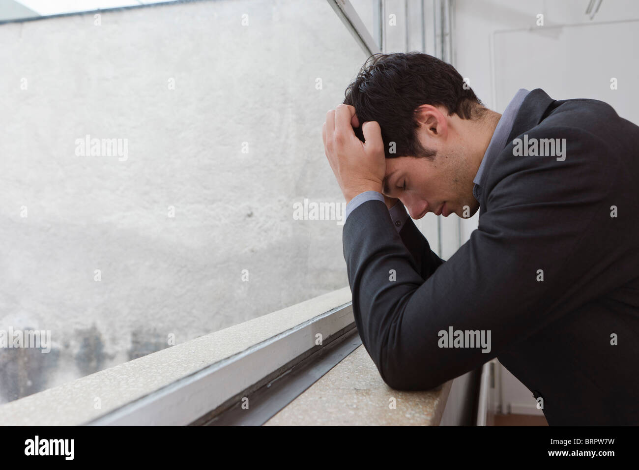 Man contemplating after a days work Stock Photo
