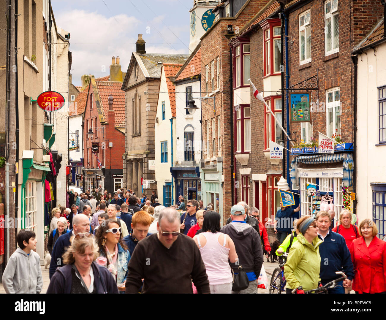 Crowded busy shopping street Whitby, North Yorkshire, England, UK - Stock Image