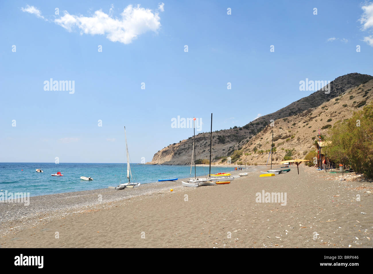 The wide and sandy beach at Mirtos in Southern Crete, Greece. - Stock Image