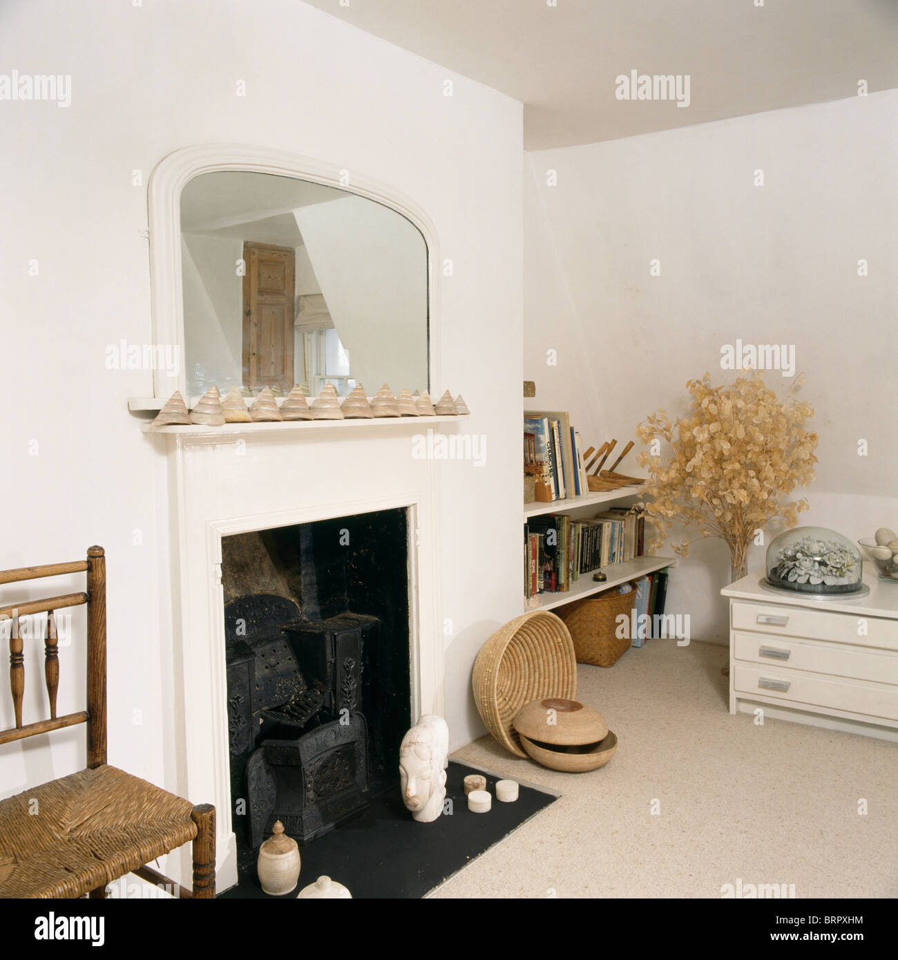 Fabulous White-painted mirror above fireplace in simple white living room  RY44