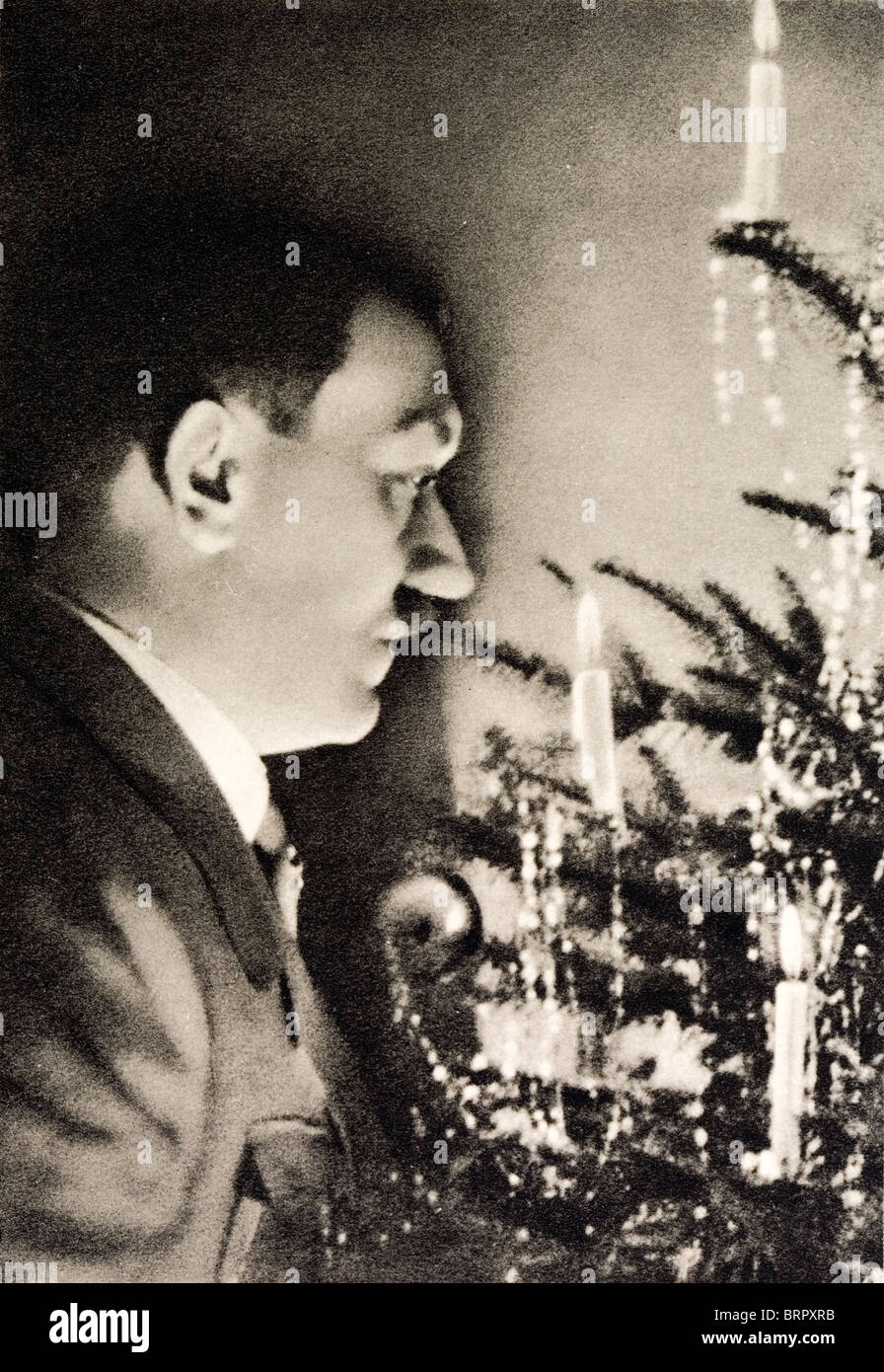 German Nazi picture showing a 'German Christmas'. Shows Adolf Hitler looking into a Christmas tree with - Stock Image