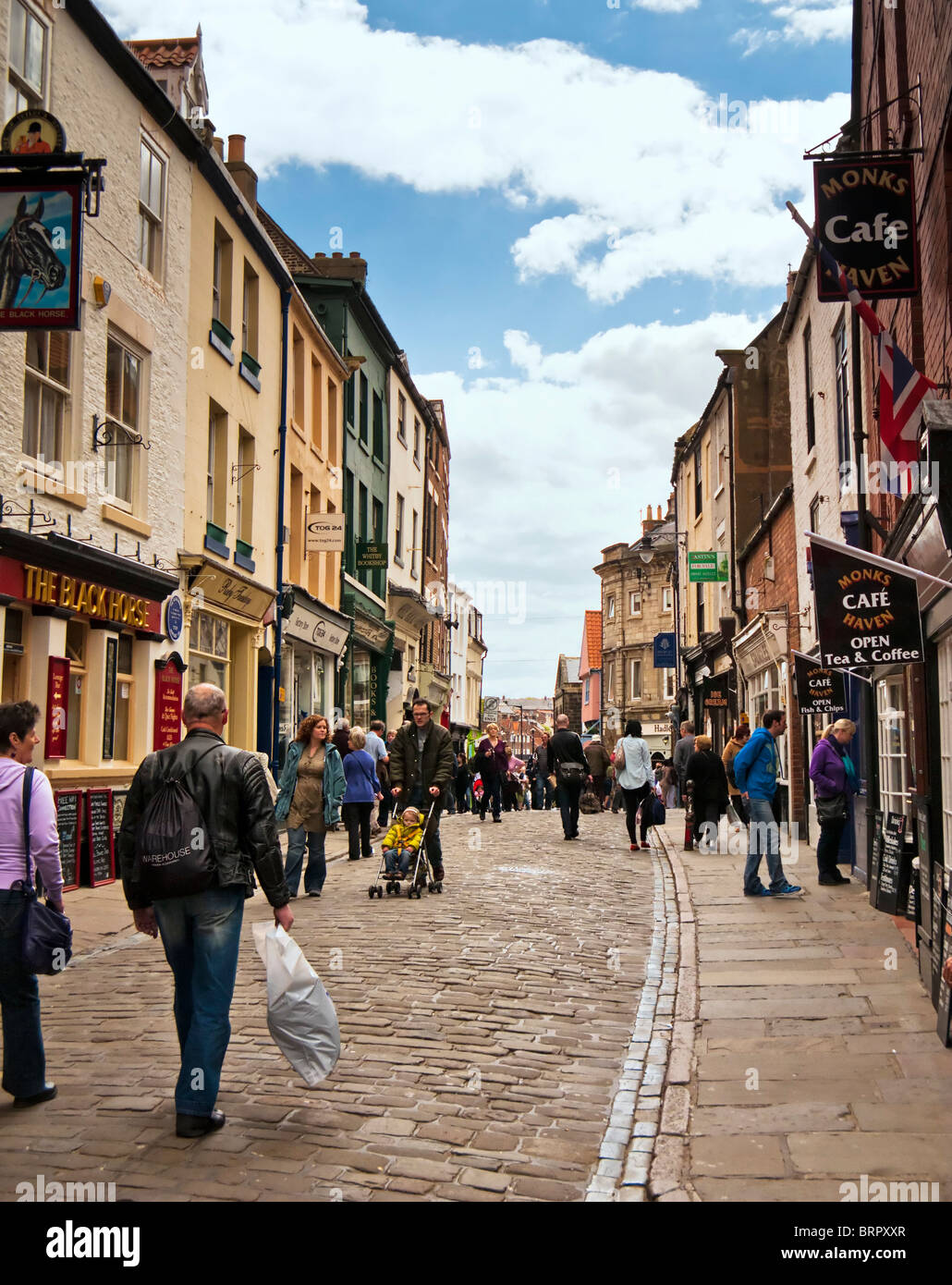 High street with people shopping in Whitby high street, North Yorkshire, England, UK - Stock Image
