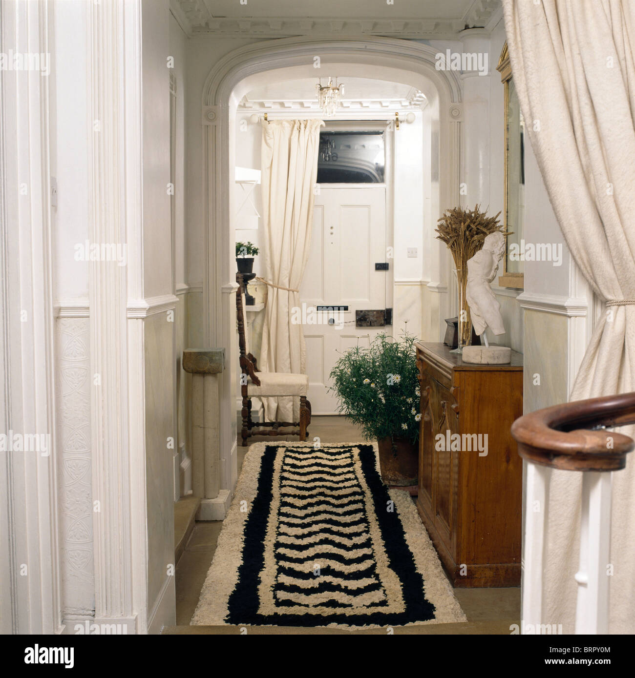Black White Rug On Floor In Narrow Hall With White Curtains And Stock Photo Alamy