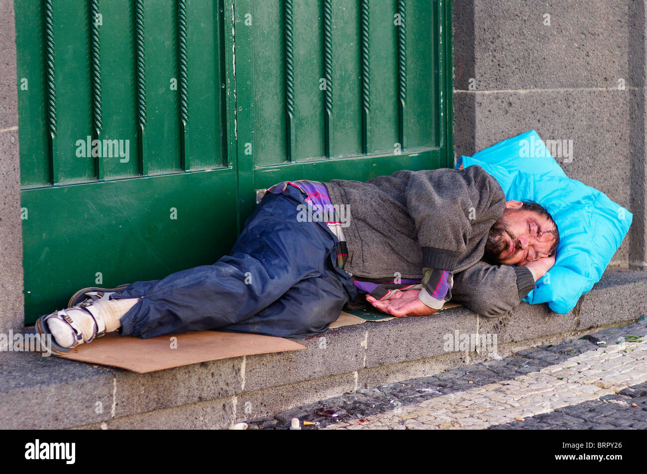 Homeless drunk and dirty men sleeping on a door step stock for Home styles com