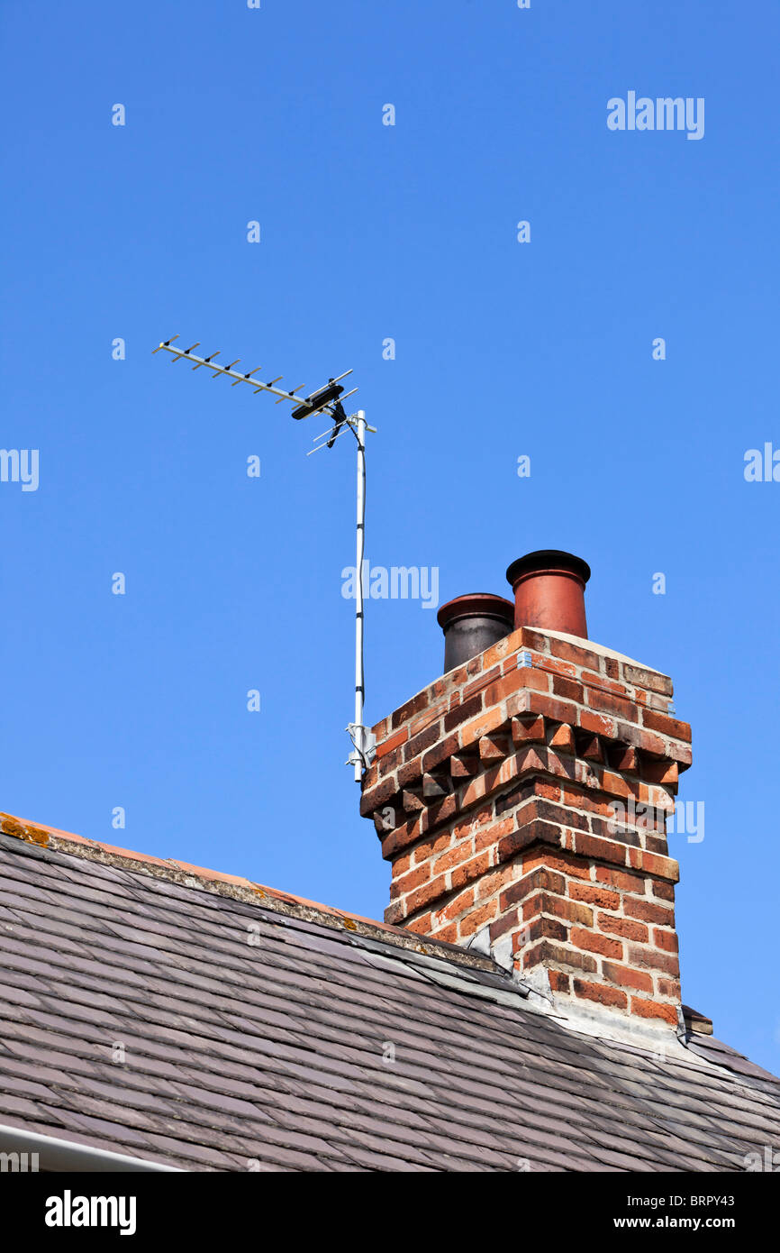 TV aerial on a red brick chimney stack UK - Stock Image