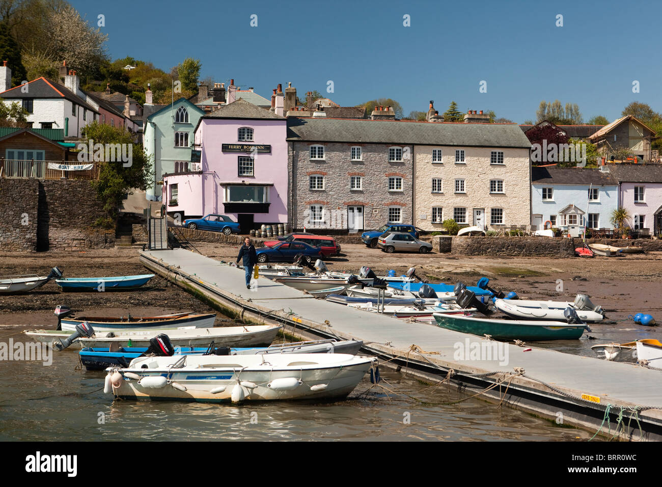 UK, England, Devon, Dittisham, boats moored in front of colourfully painted riverside houses on the Quay - Stock Image