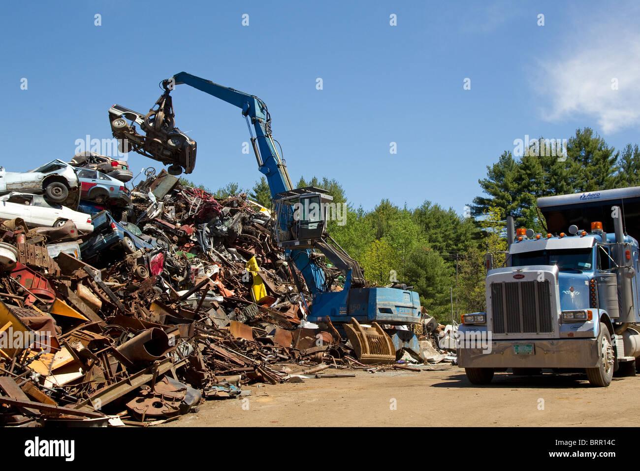 Crane loading semi truck with crushed cars, scrap metal automobiles ...